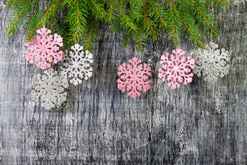 new year background from branches of a fir and snowflakes