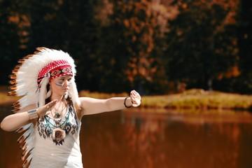 Young woman in war bonnet headdress of American Indian
