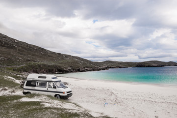 Camper van parked on beach in the Isle of Lewis, Outer Hebrides