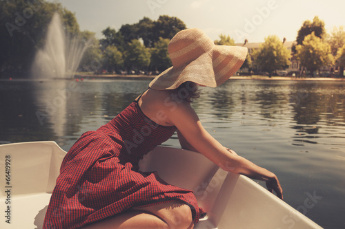 canvas print picture Young woman relaxing on the lake