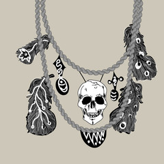 Necklace with skull and feathers