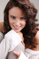 Beautiful young woman with long brown hair. Pretty model poses a