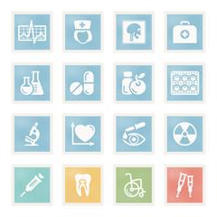 Medicine icons on paper.