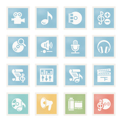 Audio video icons on paper.