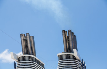 Smokestacks on Cruise Ship in Blue Sky