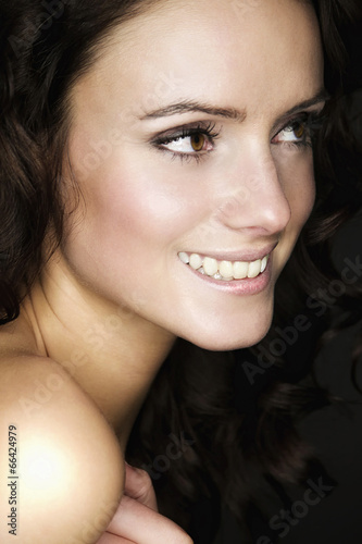 canvas print picture Beautiful young woman with long brown hair. Pretty model smiling