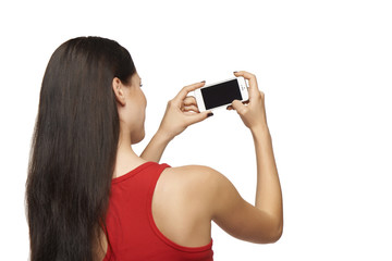 Back view of woman taking photo through cell phone