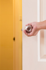 Man hand open door knob