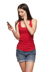 Surprised happy woman reading a sms on cell phone