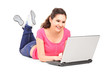 Girl lying on the floor and working with laptop