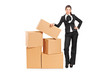 Businesswoman standing next to a pile of boxes