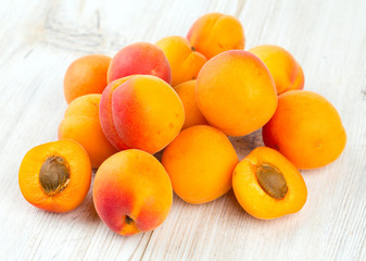 apricots on wooden surface