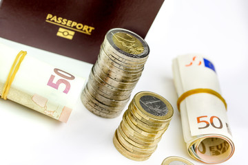 Passport and currency focuses on Euro banknotes