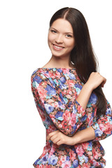 Beautiful girl wearing floral shirt standing playfully