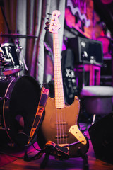 electric bass guitar on the rack at concert