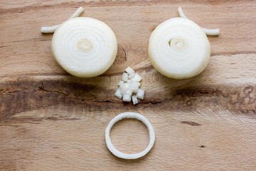 onion bulb on wooden cutting board