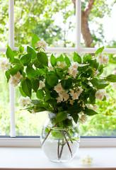 bouquet of jasmine on window-sill