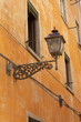 Old streetlight on a house wall, Florence, Italy