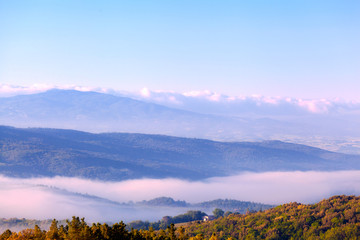 Morning fog over hills of Tuscany