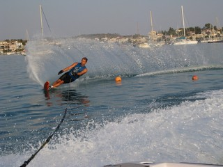 man waterskiing slalom on sea in Greece