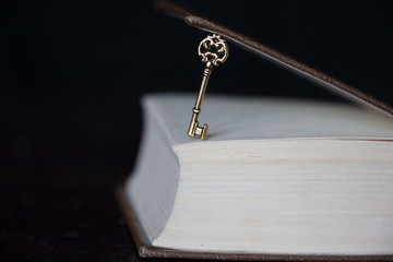 golden key and a book