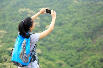 woman hiker  use smart phone mountain peak