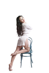 Fashion model sitting on the chair