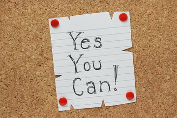 The phrase Yes You Can on a cork notice board
