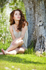 Beautiful woman under an olive tree