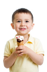 cute kid boy eating ice-cream in studio isolated