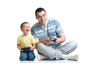 kid boy and his dad playing with a playstation together