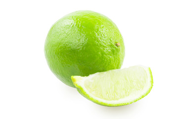 A lime and a slice of lim