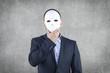 Businessman hidden behind the mask