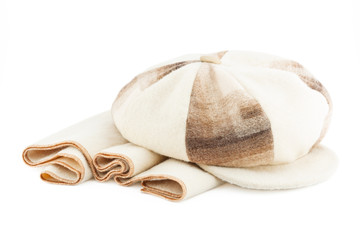 cap and beige scarf isolated on white background