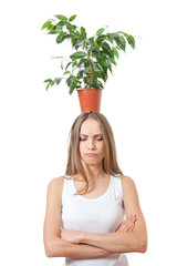Smiling woman hold houseplant isolated on white.