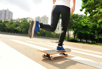skateboarder legs speeding on street