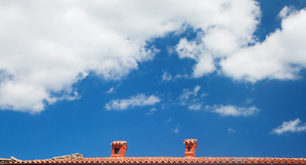 Blue sky with red roof line