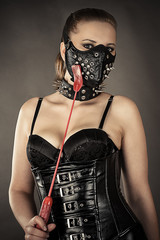 sexy woman in corset and mask with spikes