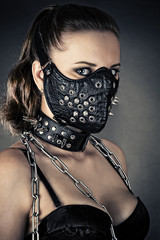 portrait of a brutal woman with mask spikes