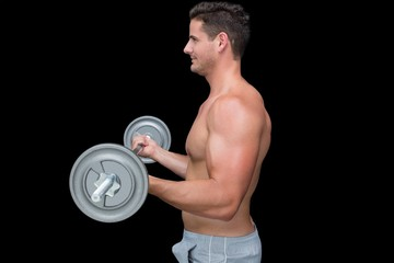 Happy handsome crossfitter lifting up barbell