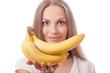 young girl holding banana
