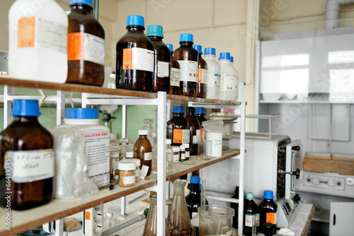 Photo of an old laboratory with a lot of bottles - 66439345