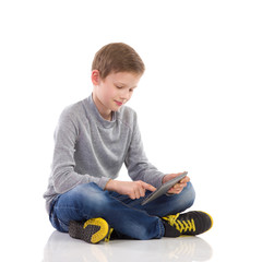 Boy using a digital tablet.