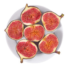 Fresh figs on a platе on a white
