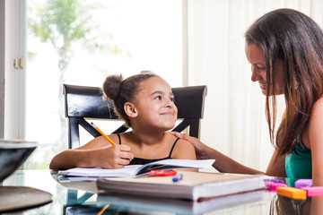 mom teaching daughter - stock image