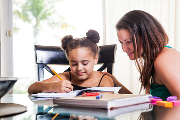 mom teaching daughter - stock image