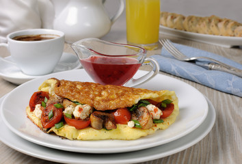 Omelette with cherry tomatoes, mushrooms and feta cheese
