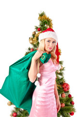 blond woman in santa hat with gift bag