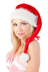 Portrait of woman in Santa's hat, isolated