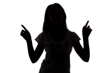 Silhouette of teenager girl with fingers up